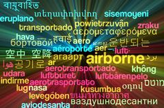 Airborne multilanguage wordcloud background concept glowing Stock Illustration