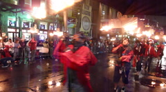 Fire walkers during Mardi Gras parade - stock footage