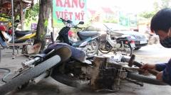 A mechanic repairing motor cars, motorcycles Stock Footage