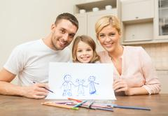 Happy family drawing at home Stock Photos