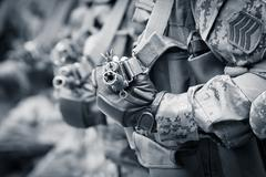 Soldiers ready for combat with assault rifles Stock Photos