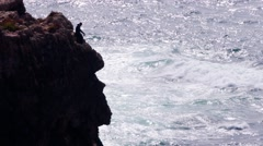 Fisherman in a cliff Stock Footage