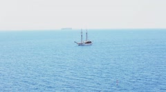 White ship with large masts against a beautiful blue Sunny sea Stock Footage