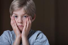 Sad depressed child - stock photo
