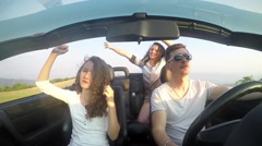 Summer Vacation Freedom Fun Party. Caucasian Family Cabriolet Driving to Trav - stock footage