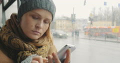 Woman texting on cell phone during bus ride in city Stock Footage