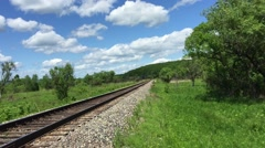 Freight green train traveling on the railroad - stock footage