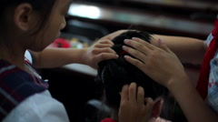 Stock Video Footage of Combing traditional hair decoration of Xunpu female