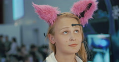 Woman in Brainwave Controlled Cat Ears Stock Footage