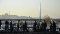 Stock Video Footage of Crowd of commuter walk over Galata Bridge, Istanbul