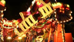 Carousel at night spinning fast - stock footage