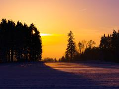 Sunset in wintertime - stock photo