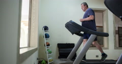 Timelapse of a senior man exercising on treadmill Stock Footage