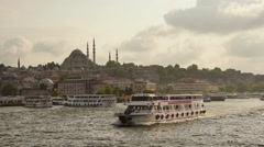 Istanbul city, Suleymaniye Mosque ; Boat is sailing, sunset Stock Footage