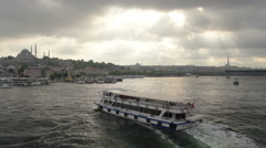 Istanbul city, Suleymaniye Mosque ; Boat is landing, cloudy Stock Footage