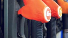 Gasoline pump nozzle at gas station Arkistovideo