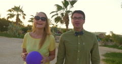 Happy young couple having enjoyable walk on tropical resort Stock Footage
