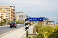 Road sign on seaside street Stock Photos