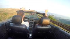 Couple Driving Convertible Cabriolet Along The Mountain Coast Road Stock Footage