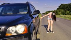 Beautiful young girl whose car broke down on the way. Stock Footage