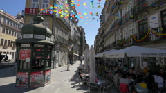Bunting waving near the outdoor restaurants in Porto Stock Footage