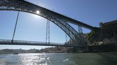 Porto sightseeing boat tour under Dom Luis Bridge Stock Footage