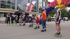 Sportsmen with skates lined up at start line and ride on stadium. 4K Stock Footage