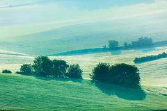 Moravian rolling fields in morning mist Stock Photos