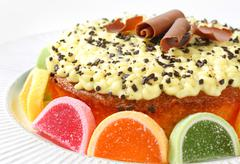 Lemon cake decorated with jelly candy - stock photo