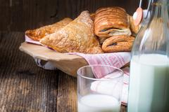 assorted breakfast pastries and milk - stock photo