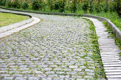 Park walkway of paving stones. - stock photo