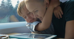 Boy and His Mother Watching Cartooins in Tablet Stock Footage