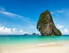 Fantastic tropical beach with white sand and karst rock in sea. Krabi, Thaila - stock photo
