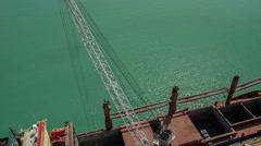 Crane flight in harbor, shipyard with ship Stock Footage
