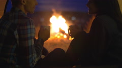 Stock Video Footage of 3 in 1 video!Pair sit and drink tea, talk, kiss and laughter in the camping tent