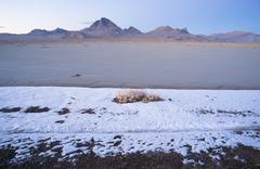Fresh Snow Bonneville Salt Flats Utah Silver Island Mountains - stock photo