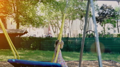 Little Girl Playing on Playground Stock Footage