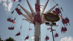 Time Lapse Theme Park Swing Ride Down - 60fps Stock Footage