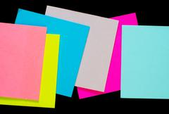 color sheets for note on black background - stock photo