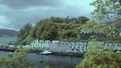 Panning shot (downward) into Portree Harbour, Scotland Stock Footage
