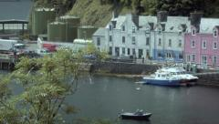 Panning shot (L to R) across Portree Harbour, Scotland Stock Footage