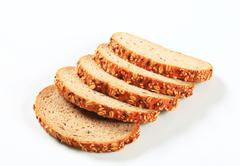 Sliced bread topped with flax and sesame seeds Stock Photos