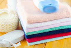 shampoo, body wash and towels - stock photo