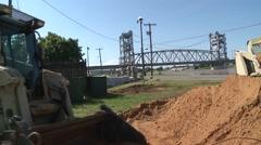 Engineers Conduct Flood Mitigation on Riverfront Stock Footage