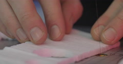 Cutting Tiny Shapes from Foam Plastic Stock Footage