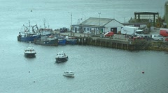 Panning shot (up) of harbour and boats at Portree, Scotland Stock Footage