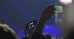 Taking shot of favorite singer with mobile - stock footage
