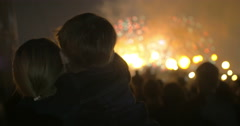 Mother and little son watching fireworks - stock footage