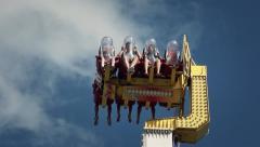 Pendulum ride zoom in people - 60fps Stock Footage