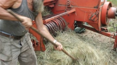 Men at work in a little farm Stock Footage